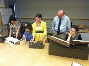 Wendy Chen, Haley Martin, Rebekah Keel, and Isabel Micaela Houtkin explore rare books with Head of Special Collections Eric Pumroy.